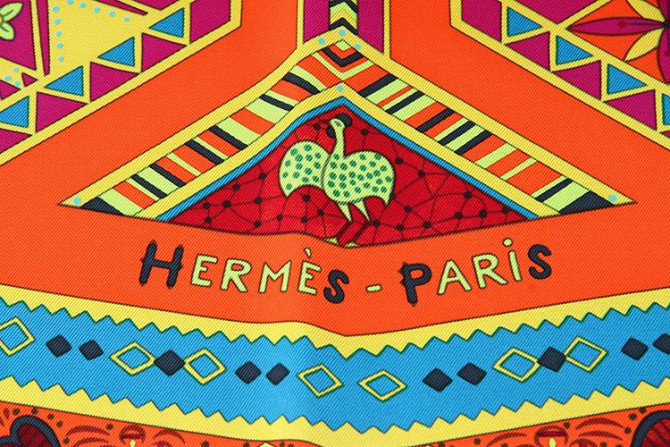 hermes(爱马仕) 橘色底动物图案丝巾图片